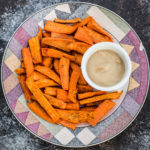 Sweet Potato Oven Fries with Maple-Garlic Tahini Dip